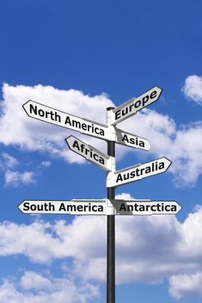 Seven continents signpost vertical