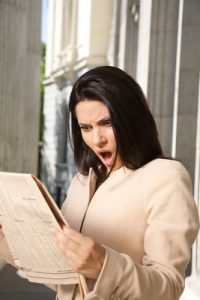 surprised businesswoman reading journal