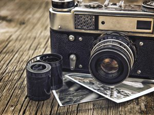 old vintage camera closeup on wooden background
